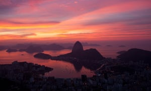 Rio+20 : Sugarloaf mountain is silhouetted during a fiery sunrise in Rio de Janeiro