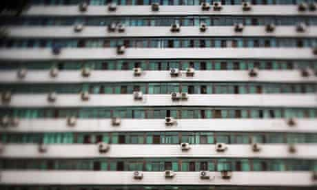 Air conditioner units dot the landscape of a Beijing apartment building, China