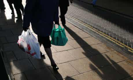 A shopper holds a plastic bags in Diss, Norfolk