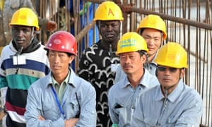 MDG : China in Africa : Seneglese and Chinese workers in Dakar, Senegal