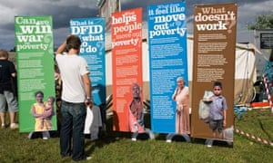 MDG : International aid : Puzzled man looking at DFID posters