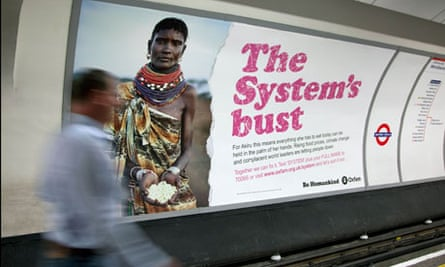 MDG : role of NGOs in development and poverty reduction : Oxfam advert in underground