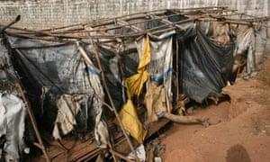 MDG : Sanitation and cholera : Public latrines in Kroo Bay slum in Freetown, Sierra Leone's capital