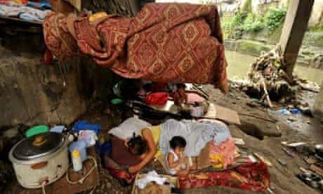MDG: Shanty home under a bridge in Manila