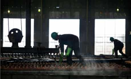 MDG : Zambia : Workers operate a plant that produces copper plates at Mopani Copper Mine