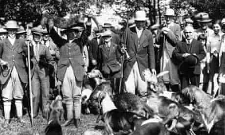 Country Diary Archive : otter hunting : whips of The Culmstock Otter Hounds holds up a 22lb otter