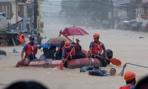 MDG : Floods in Philippines : residents evacuating from floods in Marikina City Metro Manila