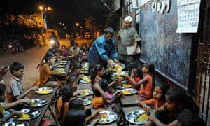 MDG : Teachers and education : teacher Kamalbhai Parmar watches students eat dinner in Ahmedabad