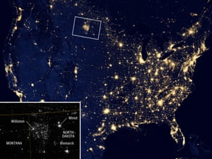 Satellite view of US at night showing North Dakota, home to shale gas, is aglow at night