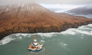 Sheel oil Arctic drilling rig Kulluk aground on the southeast shore of Sitkalidak Island