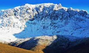 Country Diary : Pikes Crag in winter with snow on Scafell Pike