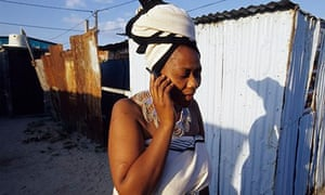 MDG : A woman speaks on her mobile phone in Cape Town, South Africa