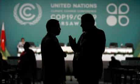COP19 in Warsaw : Delegates talk during a break in a plenary session