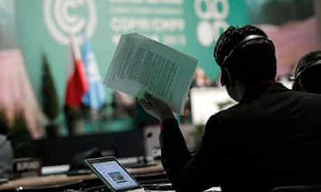 COP19 in Warsaw : man holds documents