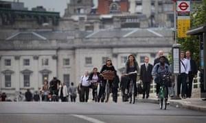 Cyclists and pedestrians make their way across Waterloo Bridge