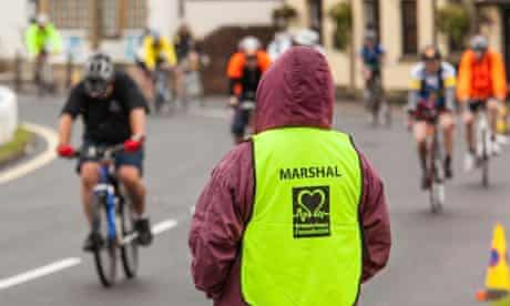 Bike blog : A race marshal in Lindfield during London to Brighton bike ride.