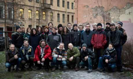 26 of the  Greenpeace Arctic 30 posing for a group picture in  St. Petersburg
