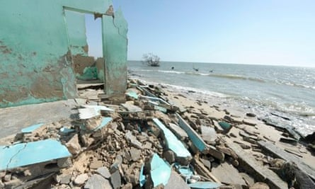 Global warming and sea levels : Ruins of a house near Saint louis, Northern coast of Senegal