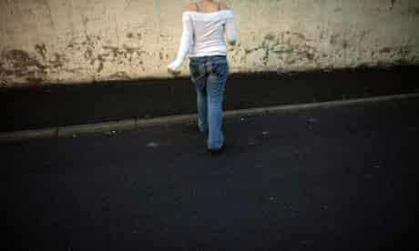 MDG : Prostitution : teenage prostitute waits for customers in the red light area