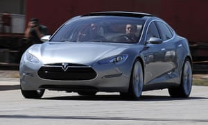 Tesla S all-electric sedan car out into the street