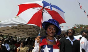 MDG : Liberia : A woman dressed in the colours of the Liberian national flag