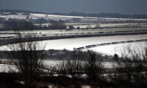 UK spring weather : A snow blizzard passes over the North York Moors
