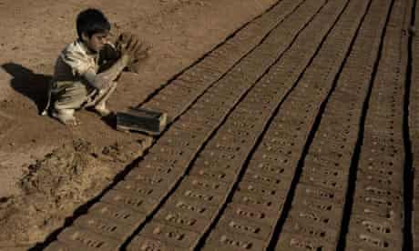 MDG : Slavery and bonded labour : A boy makes bricks at a brick factory in pakistan