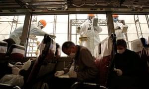Members of the media visit TEPCO's tsunami-crippled Fukushima Daiichi nuclear power plant