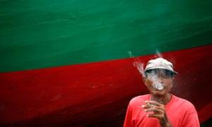 MDG Man smoking in Jakarta