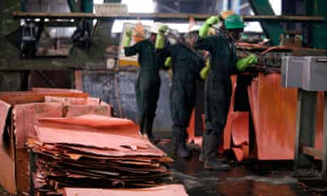 MDG : Zambia : Workers peel copper sheeting from plates, Mufulira mine in the Copperbelt region