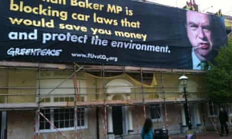 Greenpeace activists highlight the fact that Norman Baker MP opposed laws that make new cars cleaner