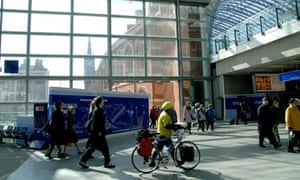 Bike blog : A cyclist pushes his bicycle through St Pancras station, Eurostar terrminal