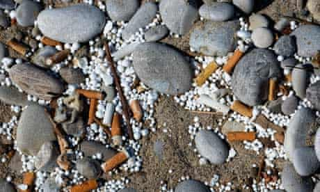 Cigarette butts ends left in the sand on a beach, beach rubbish
