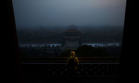 Air Pollution Attacks Beijing Again : A tourist looks at the Forbidden City as PM25 covers