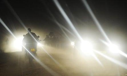 MDG : Road safety in Kenya : A man rides a motobike at night