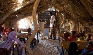 MDG : Primary school : student at the blackboard in Louri village's school hut, Chad