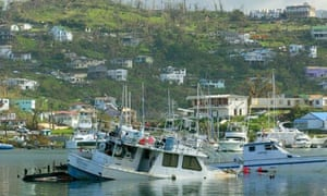 MDG : A boat floats partially submerged September 11, 2004 near St. George's, Grenada