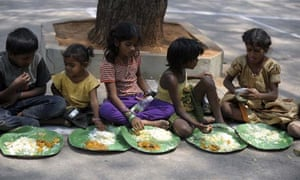 MDG : Malnutrition : Indian homeless eat food at a feeding programme for poor in Hyderabad, India