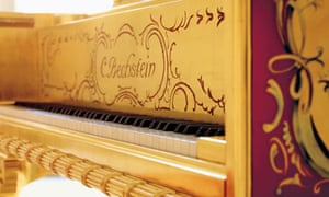 Close-up of ivory keys on legendary Golden Grand Piano Louis XV by C. Bechstein