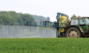 Europe ban insecticide Fipronil : A farmer drives a tractor to spray pesticides