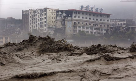 Climate change adaptation : Floods in Sichuan China:  heavy flood waters sweeping through Beichuan