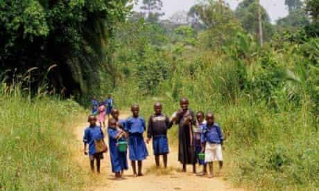Caford report :  Schoolchildren In Uniform Walking Home From School Uganda