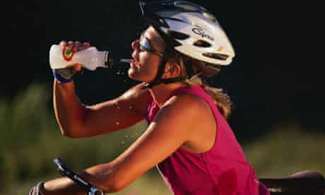 Bike Blog : Woman cyclist Having a Drink of Water