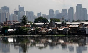 MDG : breaching inequalities : High-rise buildings in the background with slum  in Manila