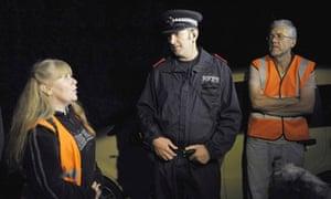 BWounded Badger Patrol volunteers talk to a policeman in Eldersfield, Gloucestershire