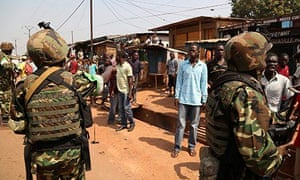 AU Burundi soldiers calm an angry mob at Gobongo district in Bangui
