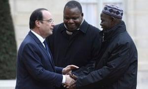 MDG : François Hollande greets Oumar Kobine Layama and Dieudonné Nzapalainga