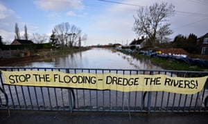 Floods defences : A banner asking for a return to dredging rivers to reduce the threat of flooding