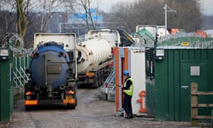 Tankers enter the fortified Barton Moss gas fracking exploration facility