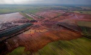 Broken dyke of a reservoir containing red mud of an alumina factory near Ajka, Hungary